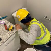 MEP Multi-Family Construction Locust Thicket, installing a toilet